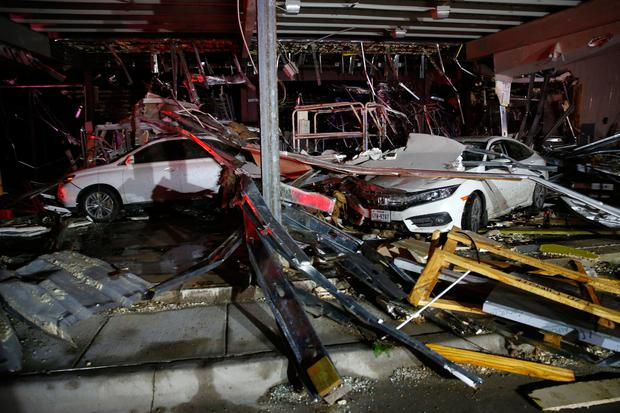 Cars and trucks are damaged as the walls blew out of the I-20 Dodge dealership after a tornado hit near Canton, Texas, Saturday, April 29, 2017 (Tom Fox/The Dallas Morning News via AP)