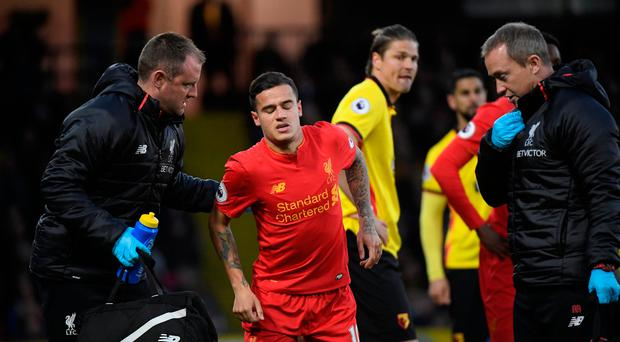 Liverpool's Philippe Coutinho receives medical attention