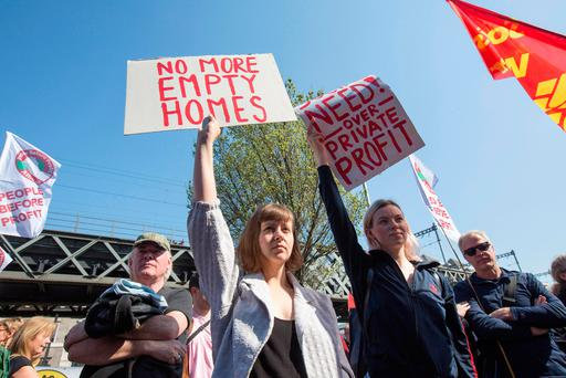 Protesters wave banners in the annual May Day march from the Garden of Remembrance to Liberty Hall in Dublin. Photo: Mark Condren