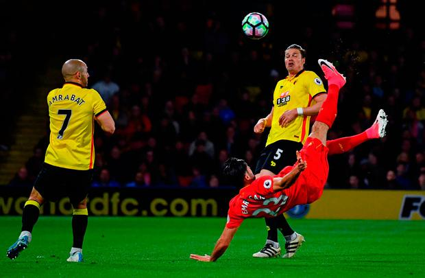 Emre Can scores his spectacular goal against Watfor. Photo by Dan Mullan/Getty Images
