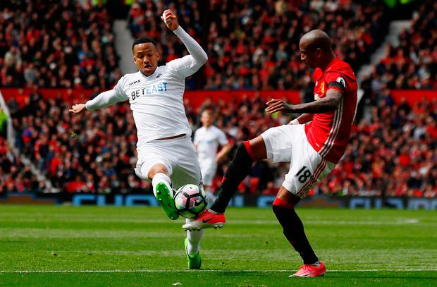 Swansea City's Martin Olsson (left) in action with Manchester United's Ashley Young. Pic: Reuters