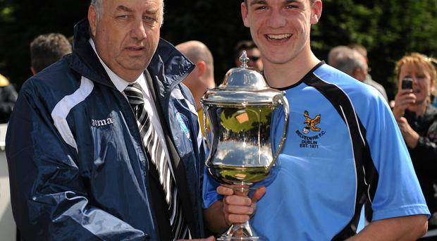 Tommy Heffernan (left) pictured presenting a cup to Darragh Lenihan
