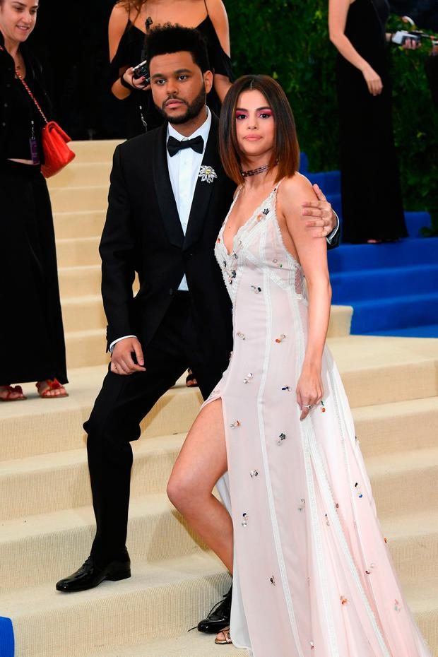 The Weeknd and Selena Gomez attend the