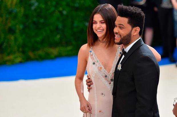 Selena Gomez (L) and The Weeknd attend the
