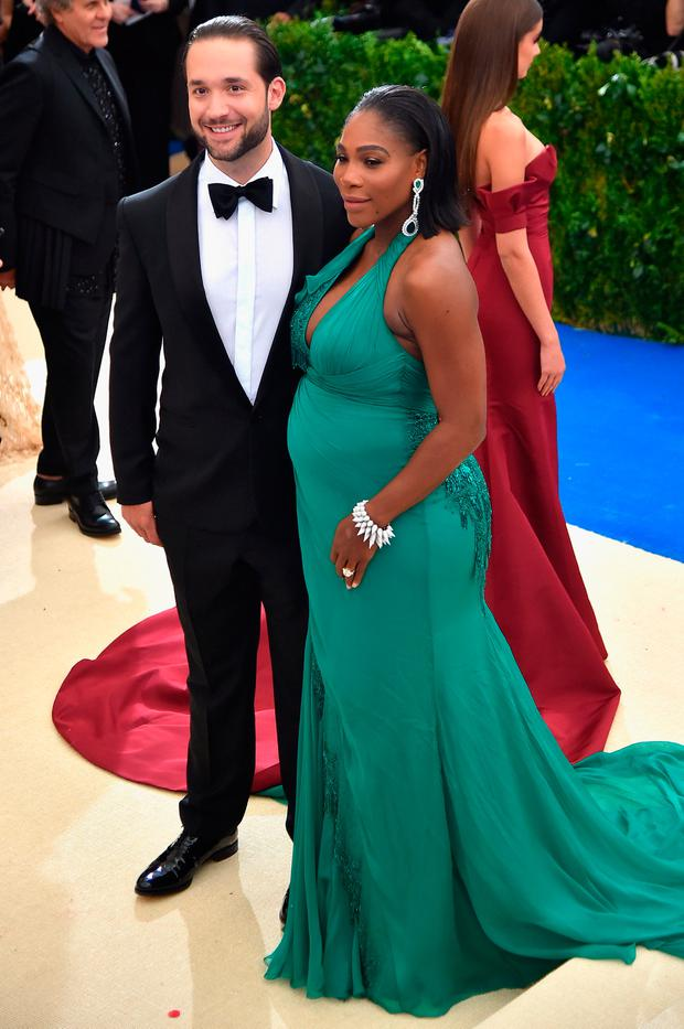 Alexis Ohanian and Serena Williams (L) attend the