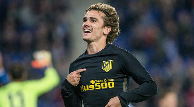 Atletico Madrid's French forward Antoine Griezmann celebrates after scoring a goal during the Spanish league football match RCD Espanyol vs Club Atletico de Madrid at the RCDE Stadium in Cornella de Llobregat on April 22, 2017. (Photo by Xavier Bonilla/NurPhoto via Getty Images)