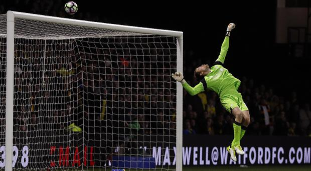 Liverpool's Belgian goalkeeper Simon Mignolet appears to save a shot from Watford's French midfielder Etienne Capoue, though a goalkick was given, during the English Premier League football match between Watford and Liverpool at Vicarage Road Stadium in Watford, north of London on May 1, 2017. / AFP PHOTO / Adrian DENNIS