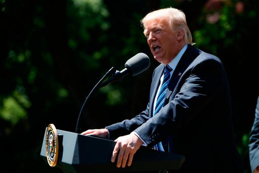 President Donald Trump speaks during a presentation ceremony of the Commander-in-Chief trophy to the Air Force Academy football team, Tuesday, May 2, 2017, in the Rose Garden of the White House. (AP Photo/Evan Vucci)