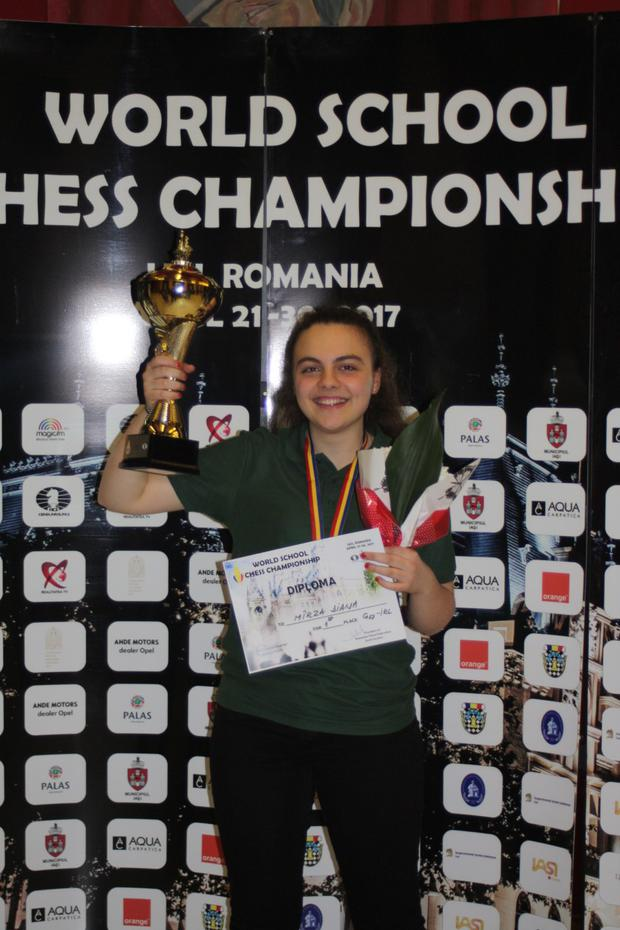 Diana Mirza lifts the world championship trophy