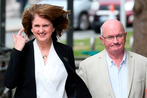 Joan Burton arrives at court with her husband Pat Carroll yesterday. Photo: Collins Courts