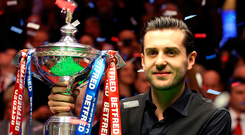 Mark Selby with the World Championship trophy after beating John Higgins. Photo: PA