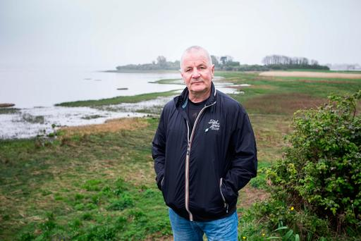 Councillor Mike McKee by the Shannon Estuary in Co Clare. Photo: Eamon Ward
