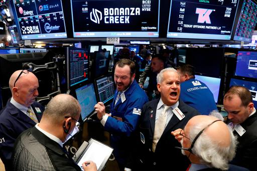 Traders gather for the opening of Bonanza Creek Energy Inc. as it begins trading on the floor of the New York Stock Exchange (NYSE)