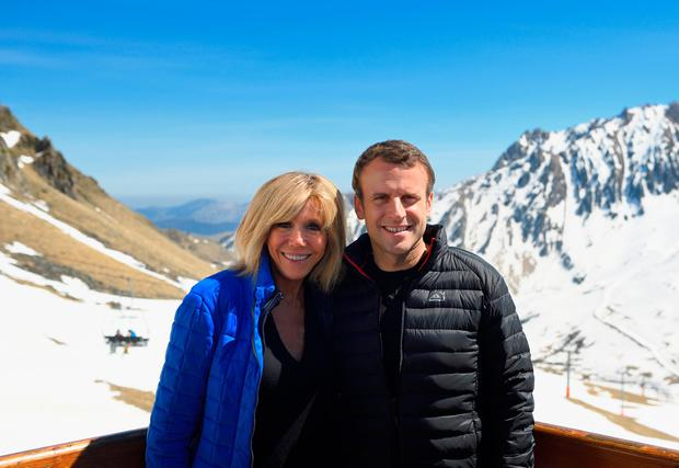 French presidential election candidate for the En Marche movement Emmanuel Macron (R) and his wife Brigitte Trogneux who is 25 years his senior