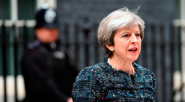 British Prime Minister Theresa May makes a statement in Downing Street, London, after visiting Queen Elizabeth II at Buckingham Palace. Photo: Stefan Rousseau/PA Wire