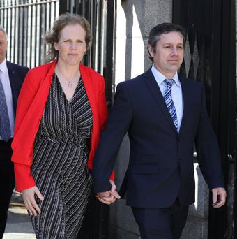 L-R: Rachel and Verdun Hayes, parents of Gemma Hayes from Ballinlough, Cork, pictured leaving the Four Courts with their Solicitor, Colm O Riain Pic: Collins Courts