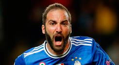 Juventus' Gonzalo Higuain celebrates scoring their opener