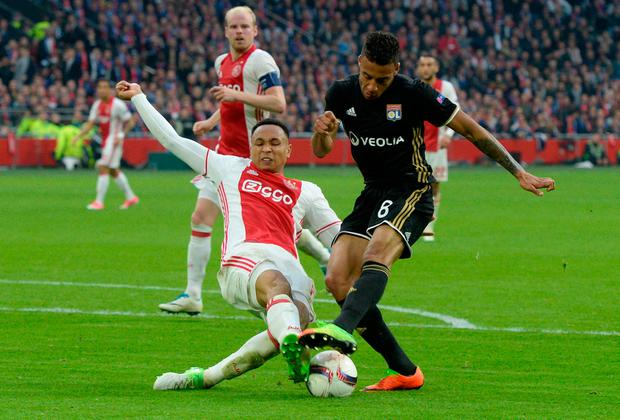 Ajax's Kenny Tete tackles Corentin Tolisso. Photo: Reuters