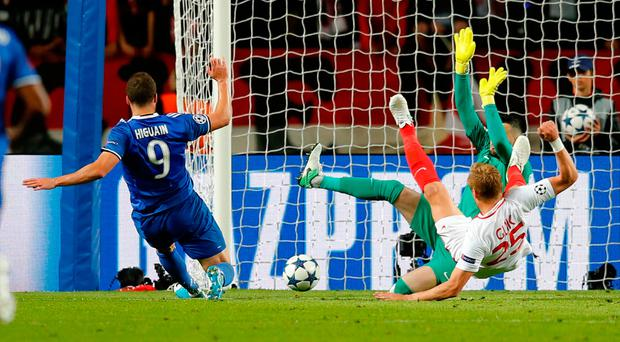 Gonzalo Higuain finds space in the Monaco defence to slot in his second goal and make Juventus firm favourites to reach the Champions League final. Photo: REUTERS