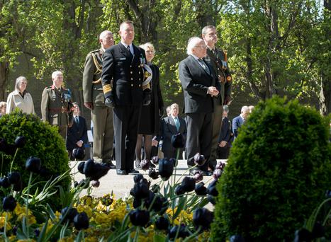 President Michael D Higgins and his wife Sabina stand with members of the Defence Forces at the Arbour Hill Commemoration Ceremony in Dublin. Photo: Defence Forces