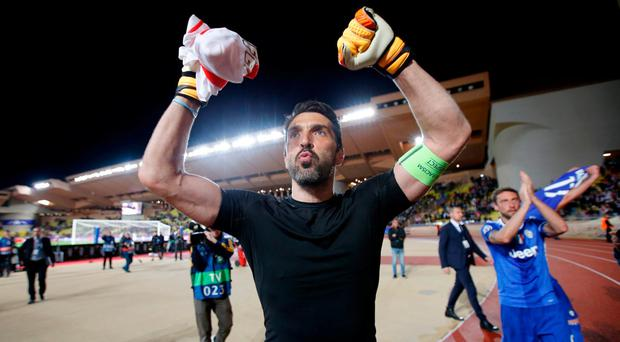 Juventus' Gianluigi Buffon celebrates after last night's match