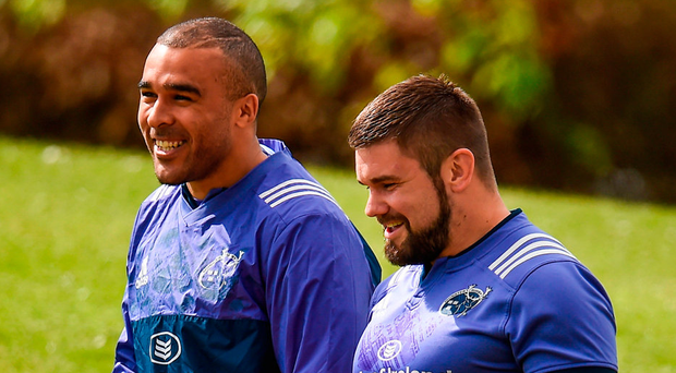 Duncan Casey arrives at training with Simon Zebo. Photo: Seb Daly/Sportsfile
