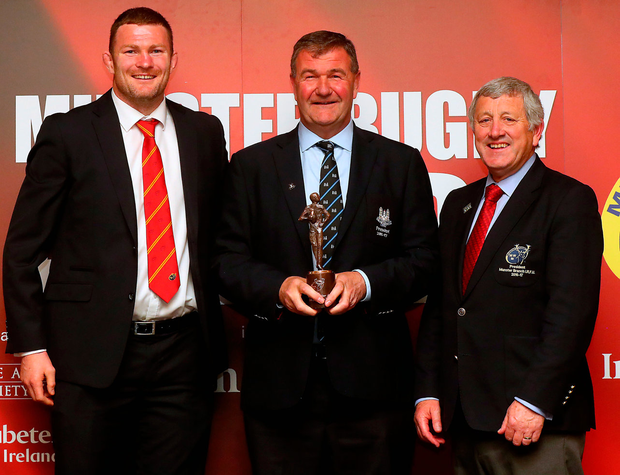 Cork Constitution chairperson Jerry Holland accepts the Senior Club of the Year award from Donnacha Ryan and Munster Branch president Gerry O'Shea. Photo: James Crombie/INPHO