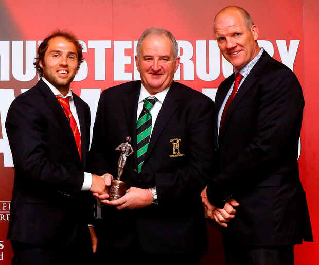 Clonmel RFC president Michael Hoyne accepts the Junior Club of the Year award from Duncan Williams and Ultan O'Callaghan, Munster's head of rugby development. Photo: James Crombie/INPHO