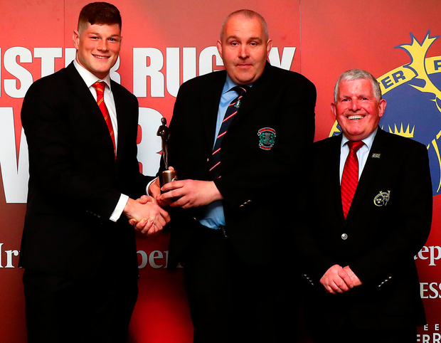 Nenagh Ormond youth co-ordinator Martin Brislane accepts the Club Youth Section of the Year award from Jack O'Donoghue and Munster Branch secretary Joe Murphy. Photo: James Crombie/INPHO