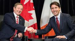 Taoiseach Enda kenny greets Canadian Prime Minister Justin Trudeau in Montreal. Photo: Paul Chiasson