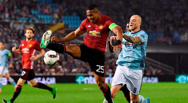 Antonio Valencia puts his best foot forward as he battles it out with John Guidetti of Celta Vigo. Photo: David Ramos/Getty Images