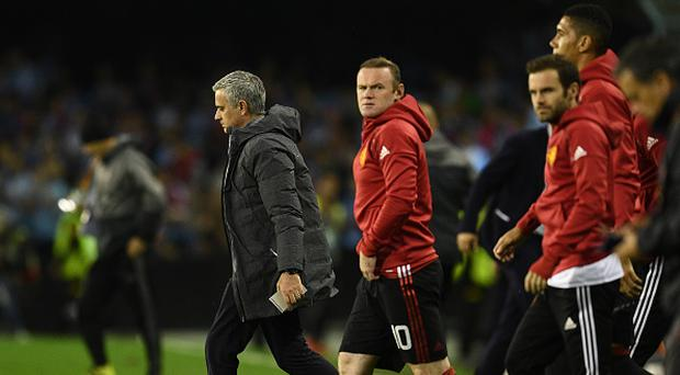 Jose Mourinho manager of Manchester United and Wayne Rooney of Manchester United look on at half time during the UEFA Europa League semi final, first leg match between Celta Vigo and Manchester United at the Estadio Balaidos on May 4, 2017 in Vigo, Spain. (Photo by David Ramos/Getty Images)