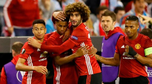 Manchester United's Marcus Rashford celebrates scoring their first goal with team mates. Photo: Carl Recine/Action Images via Reuters