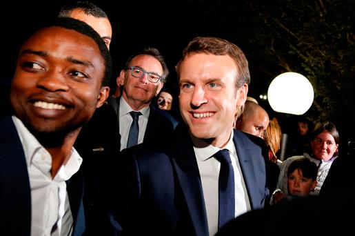 Emmanuel Macron, head of the political movement En Marche !, or Onwards !, and candidate for the 2017 presidential election, speaks with supporters at the restaurant Bowling in Rodez, France, May 4, 2017. REUTERS/Regis Duvignau