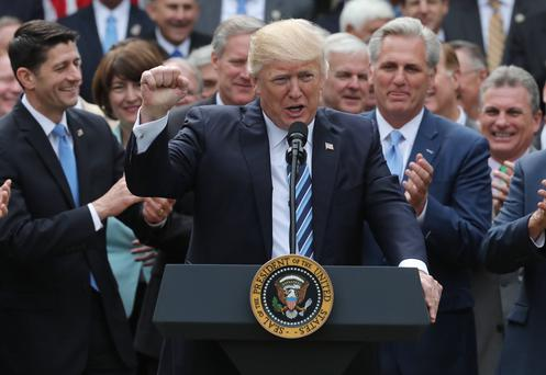 US President Donald Trump celebrates with Congressional Republicans in the Rose Garden of the White House after the House of Representatives approved the American Healthcare Act