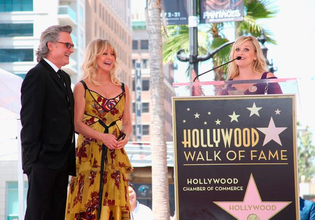(L-R) Honorees Kurt Russell, Goldie Hawn and actor Reese Witherspoon at Goldie Hawn and Kurt Russell are honored with a Star On the Hollywood Walk of Fame on May 4, 2017 in Hollywood, California. (Photo by Jesse Grant/Getty Images for Disney)