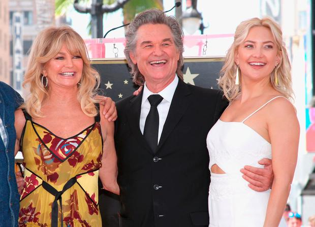 =(L-R) Honorees Goldie Hawn, Kurt Russell and actor Kate Hudson at Goldie Hawn and Kurt Russell are honored with a Star On the Hollywood Walk of Fame on May 4, 2017 in Hollywood, California. (Photo by Jesse Grant/Getty Images for Disney)
