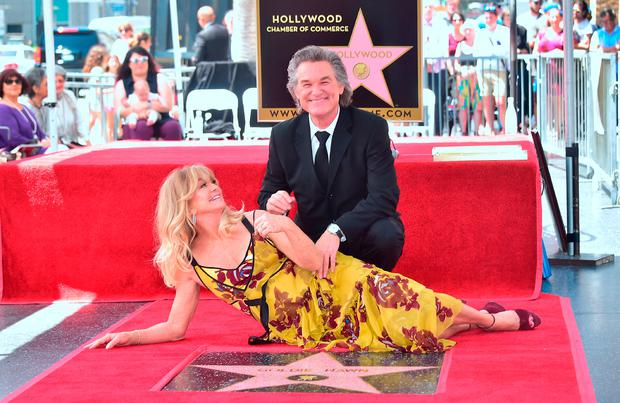 Goldie Hawn and Kurt Russell pose at their Walk of Fame Stars ceremony in Hollywood, California on May 4, 2017. / AFP PHOTO / FREDERIC J. BROWNFREDERIC J. BROWN/AFP/Getty Images