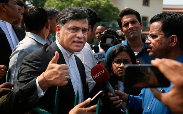 Siddhartha Luthra, a prosecutor in the fatal 2012 gang rape on a moving bus, displays a thumbs up after the Supreme court verdict in New Delhi, India, Friday, May 5, 2017. (AP Photo/Altaf Qadri)