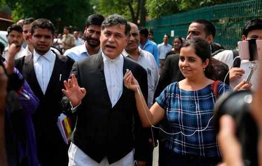 Siddhartha Luthra, a prosecutor in the fatal 2012 gang rape on a moving bus, speaks to reporters after the Supreme court verdict in New Delhi, India, Friday, May 5, 2017. (AP Photo/Altaf Qadri)