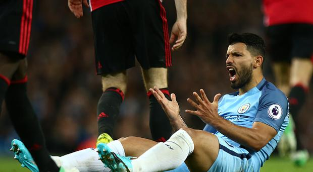 Sergio Aguero of Manchester City reacts during the Premier League match between Manchester City and Manchester United at Etihad Stadium on April 27, 2017 in Manchester, England. (Photo by Robbie Jay Barratt - AMA/Getty Images)