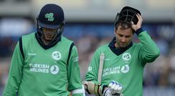 Tim Murtagh and Peter Chase of Ireland leave the field after their team was dismissed during the 1st Royal London one-day international cricket match between England and Ireland at the Brightside cricket ground on May 5, 2017 in Bristol, England. (Photo by Philip Brown/Getty Images)