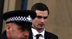 Footballer Adam Johnson (R) leaves Bradford Crown Court for day thirteen of the trial where he is facing child sexual assault charges on March 1, 2016 in Bradford, England. The former Sunderland FC midfielder, 28, from Castle Eden, County Durham, has admitted one charge of sexual activity with a child and one charge of child grooming, but denies two further counts of sexual activity with a child. (Photo by Nigel Roddis/Getty Images)
