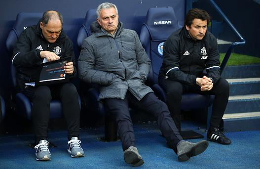 Jose Mourinho, Manager of Manchester United (C) and his backroom staff await kick off during the Premier League match between Manchester City and Manchester United at Etihad Stadium on April 27, 2017 in Manchester, England. (Photo by Clive Brunskill/Getty Images)