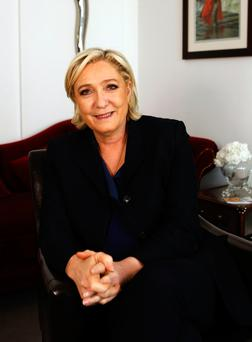 French far-right candidate for the presidential elections Marine Le Pen poses after an interview with the Associated Press(AP Photo/Laurent Rebours)