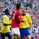 Arsenal's Martin Keown is elated following Ruud Van Nistelrooy's penalty miss in 2003. Photo: Getty