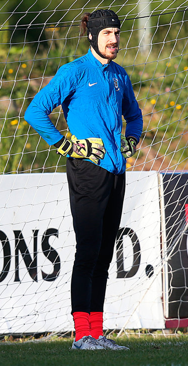 Goalkeeper Igor Labuts warms up before the game Photo: Steve Humphreys