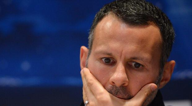 Manchester United's Welsh midfielder Ryan Giggs looks on during a press conference at Old Trafford in Manchester, north-west England on March 4, 2013, on the eve of their UEFA Champions League first knockout round second leg football match against Real Madid. AFP PHOTO/ANDREW YATES. (Photo credit should read ANDREW YATES/AFP/Getty Images)