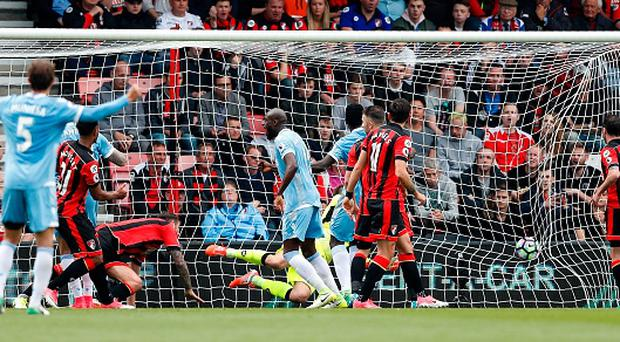 Bournemouth's French midfielder Lys Mousset (2L) watches the ball after scoring an own goal during the English Premier League football match between Bournemouth and Stoke City at the Vitality Stadium in Bournemouth, southern England on May 6, 2017. / AFP PHOTO / Adrian DENNIS