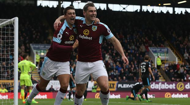 BURNLEY, ENGLAND - MAY 06: Burnley's Sam Vokes celebrates scoring the opening goal with team-mate Matthew Lowton during the Premier League match between Burnley and West Bromwich Albion at Turf Moor on May 6, 2017 in Burnley, England. (Photo by Stephen White - CameraSport via Getty Images)